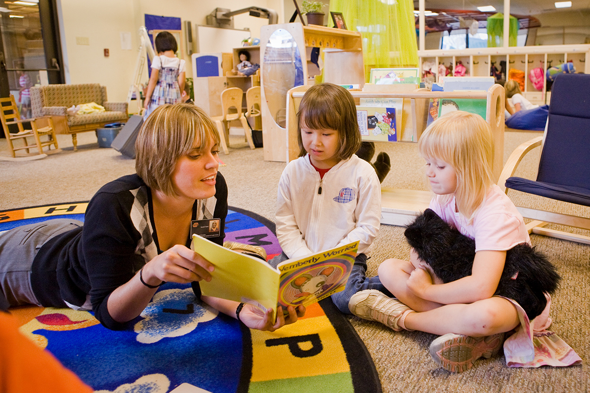 Teacher and students in a child care environment